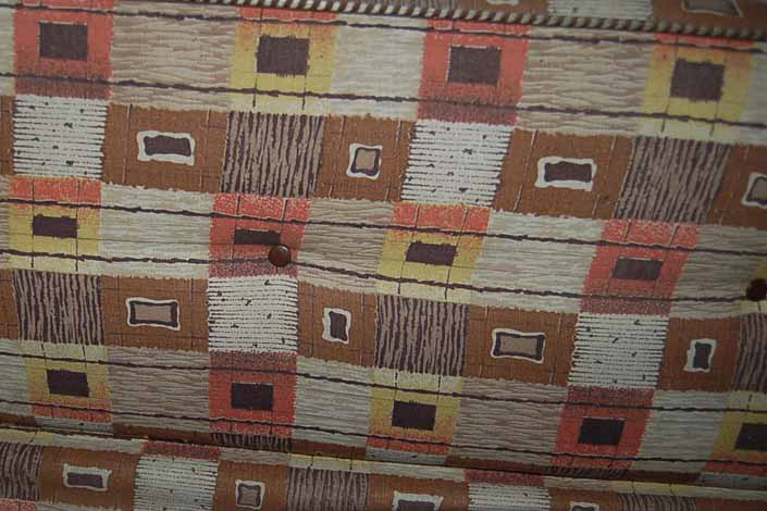 This photo shows a swatch of retro fabric from an original 1960's Shasta trailer cushion, for your vintage trailer