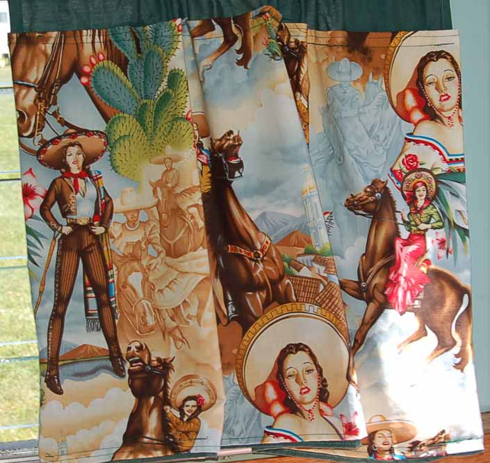 This photo shows a swatch of retro fabric with classy Cowgirls and Senoritas, for your vintage trailer
