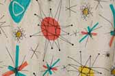 This image is a sample of a great looking retro fabric pattern with googies starbursts designs, for your vintage trailer