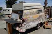 Original fiberglass 1954 Kompak trailer uses styling and tail lights from a 1954 Ford