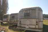Picture shows a group of original Silver Streak trailer stored in a vintage trailer junk yard and available for restoration