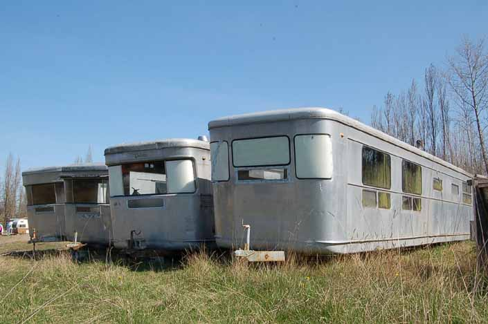Vintage trailer Storage Yard has row of Spartan Manor vintage trailers ready for restoration