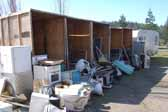 Large collection of original appliances and fixtures salvaged from vintage trailers and now stored in a vintage trailer junk yard