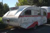 Original Aero Flite trailer in a vintage trailer storage yard is very restorable and would be a great restoration project