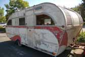 Classic Aero Flite trailer stored in a vintage trailer Junk Yard awaiting restoration
