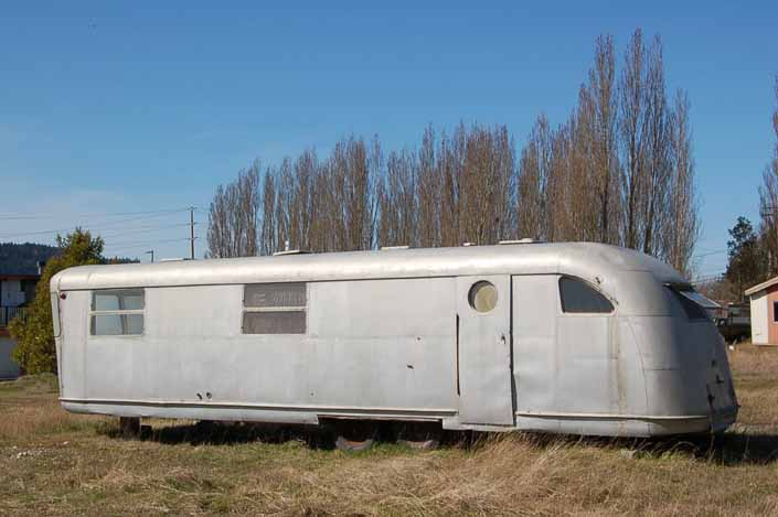 Original Spartan Manor trailer stored in a vintage trailer junkyard is a good candidate for restoration