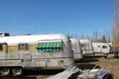 Nice collection of vintage Silver Streak trailers found in a vintage trailer storage yard