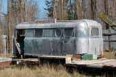Photo of a rare Palace trailer stored in a vintage trailer junkyard and ready to be restored
