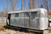 Close-up view of a rare Palace trailer found in a vintage trailer junkyard