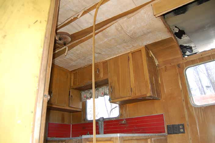 Palace vintage trailer found in a vintage trailer Storage Yard with its original ceiling paneling and kitchen wood work