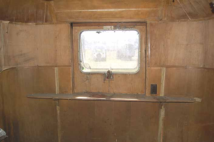 Palace vintage trailer found in a vintage trailer Storage Yard still has its original interior wood paneling