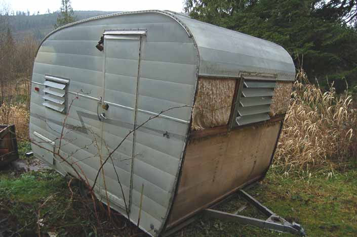 Restorable Shasta COmpact trailer parked in a vintage trailer Storage-Yard