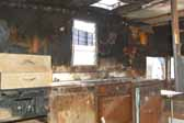 Photo shows extensive interior fire damage to a Shasta trailer found in a vintage trailer storage yard