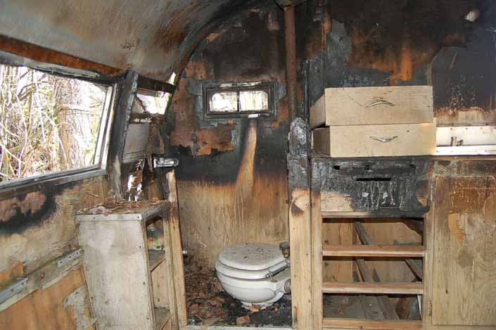 Shasta 16SC trailer in a vintage trailer Storage Yard has severe fire damage to the bathroom area