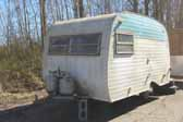 Vintage Serro Scotty trailer abandoned in a vintage trailer storage yard