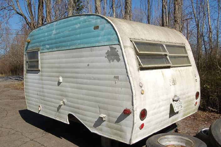 Vintage trailer storage yard has a vintage Serro-Scotty trailer, ready for restoration