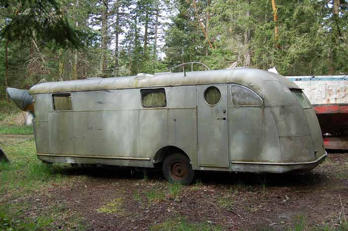 Classic Spartan Manor trailer in a vintage trailer Storage Yard would be a great restoration project