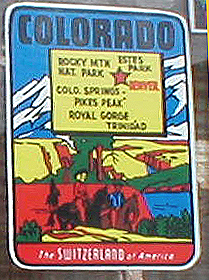 Vintage Travel Decal highlights popular mountain parks in Colorado, with the slogan: The Switzerland of American