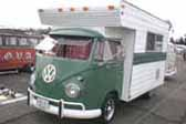 Very nicely built truck-based custom camper is a large camper shell mounted on a vintage Volkswagen Bus