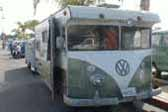 truck-based camper is an old trailer mated to a vintage VW bus body, skillfully modified to blend VW nose into the front of the camper