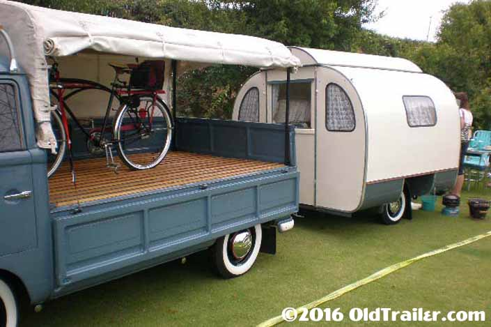 This vintage towing rig is a vintage volkswagen single cab pickup truck pulling a vintage trailer